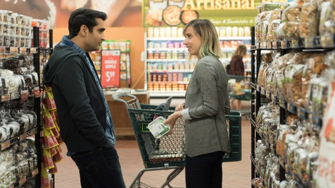 Kumail Nanjiani playing himself talking to Zoe Kazan playing his wife Emily.