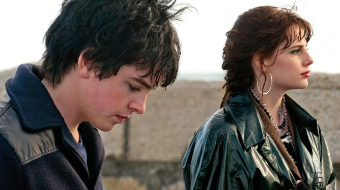 Ferdia Walsh-Peelo and Lucy Boynton  looking out to sea in Sing Street