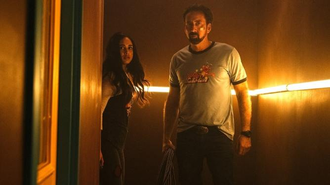 Emily Tosta with Nicolas Cage as the badass janitor as seen in Willy's Wonderland.