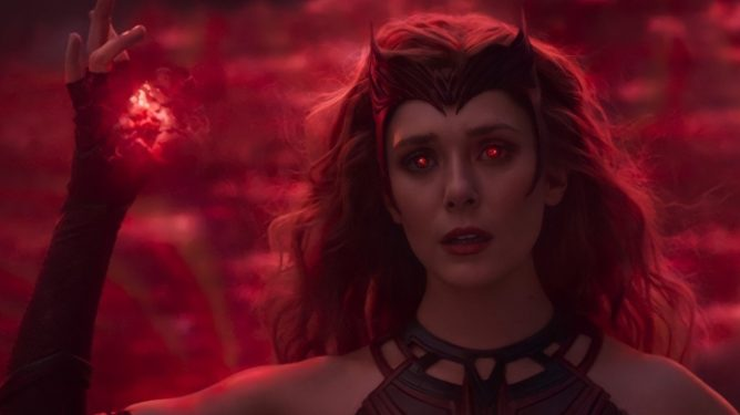 Wanda Maximoff glows with red power and finally becomes the Scarlet Witch as seen in the series finale of WandaVision.