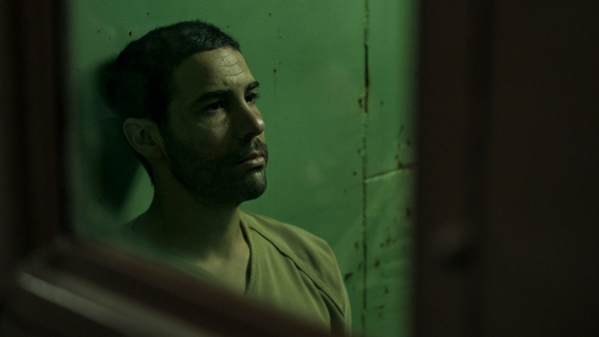 Tahar Rahim as Mohamedou Ould Slahi in a jail cell as seen in The Mauritanian.