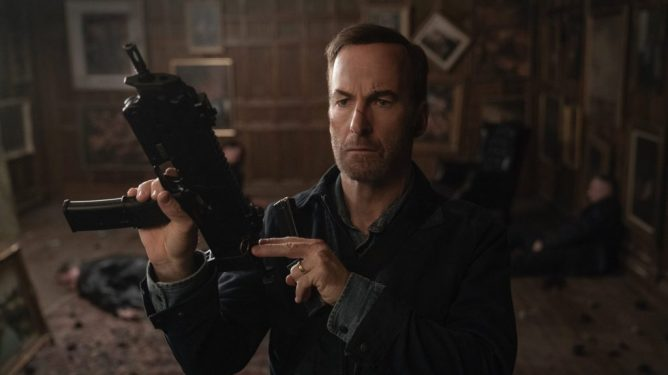Bob Odenkirk reloading an assault rifle as seen in the action comedy Nobody.