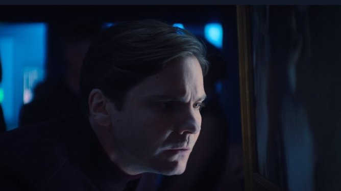 Daniel Brühl as Baron Zemo examining some fine art as seen in Episode 3 of The Falcon and the Winter Soldier.