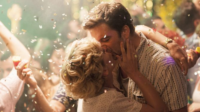 Sebastian Stan and Denise Gough kissing passionately at a Greek festival party as seen in the film Monday.