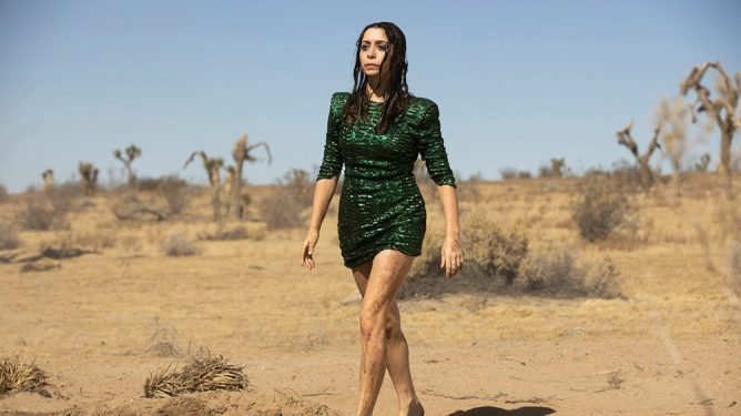 Cristin Milioti walks barefoot in the desert while wearing an emerald dress as seen in the HBO Max original series Made for Love.