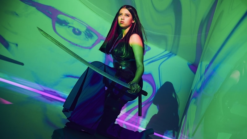Amber Midthunder wielding a sword in front of a psychedelic backdrop as seen in FX's Legion, she will next star in the upcoming new Predator film.