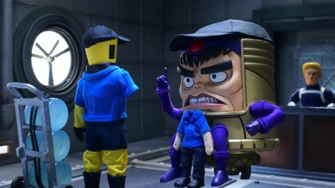 M.O.D.O.K. voiced by Patton Oswalt scolding his AIM employees while wearing a dad hat as seen in the new stop motion series on Hulu.