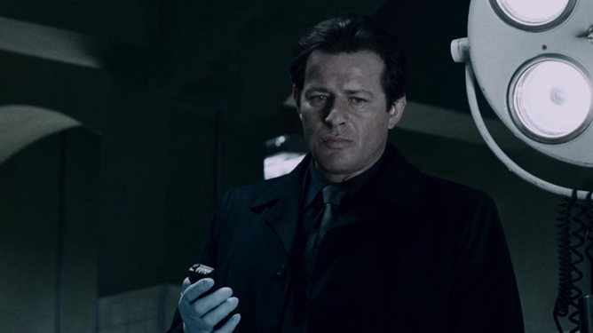 Mark Hoffman played by Costas Mandylor in the morgue overlooking Jigsaw's corpse as seen in Saw IV.