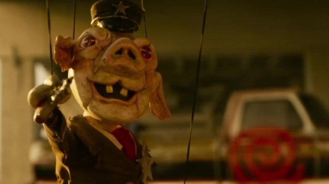 The Jigsaw killer's latest puppet is an evil pig dressed in a cop uniform as seen in Spiral: From the Book of Saw directed by Darren Lynn Bousman.