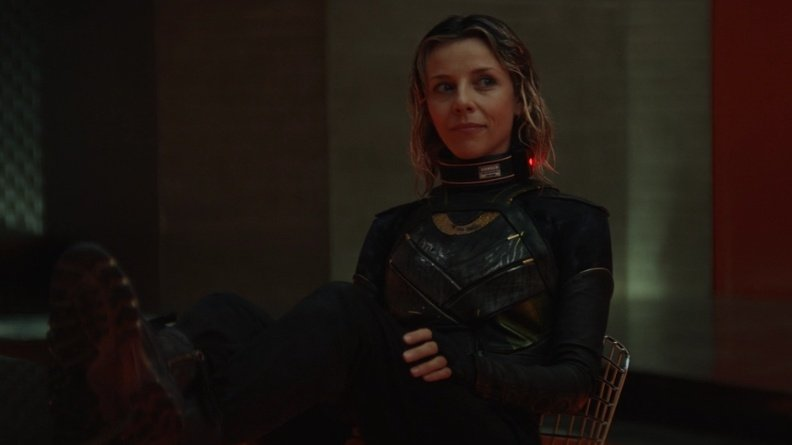 Sylvie played by Sophia Di Martino smirking and sitting with her legs up in a TVA interrogation room as seen in Episode 4 of LOKI on Disney+.