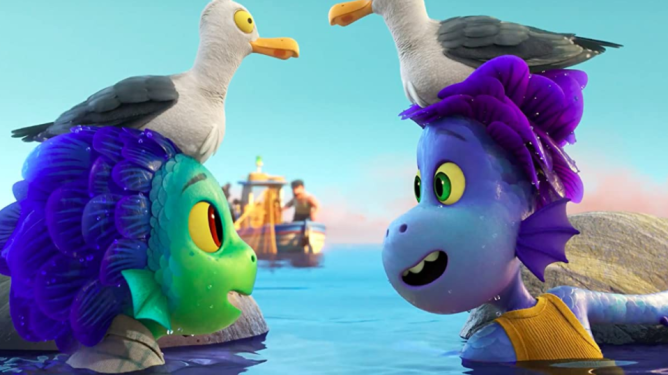 Luca and Alberto as sea monsters hiding on the Italian shore with seagulls on their heads as seen in Pixar's Luca on Disney+.