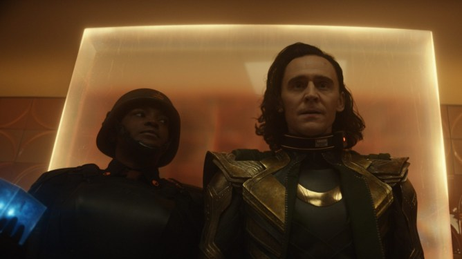Wunmi Mosaku as Hunter B-15 holding Loki under arrest as he enters the TVA for the first time as seen in the Loki series premiere on Disney+.