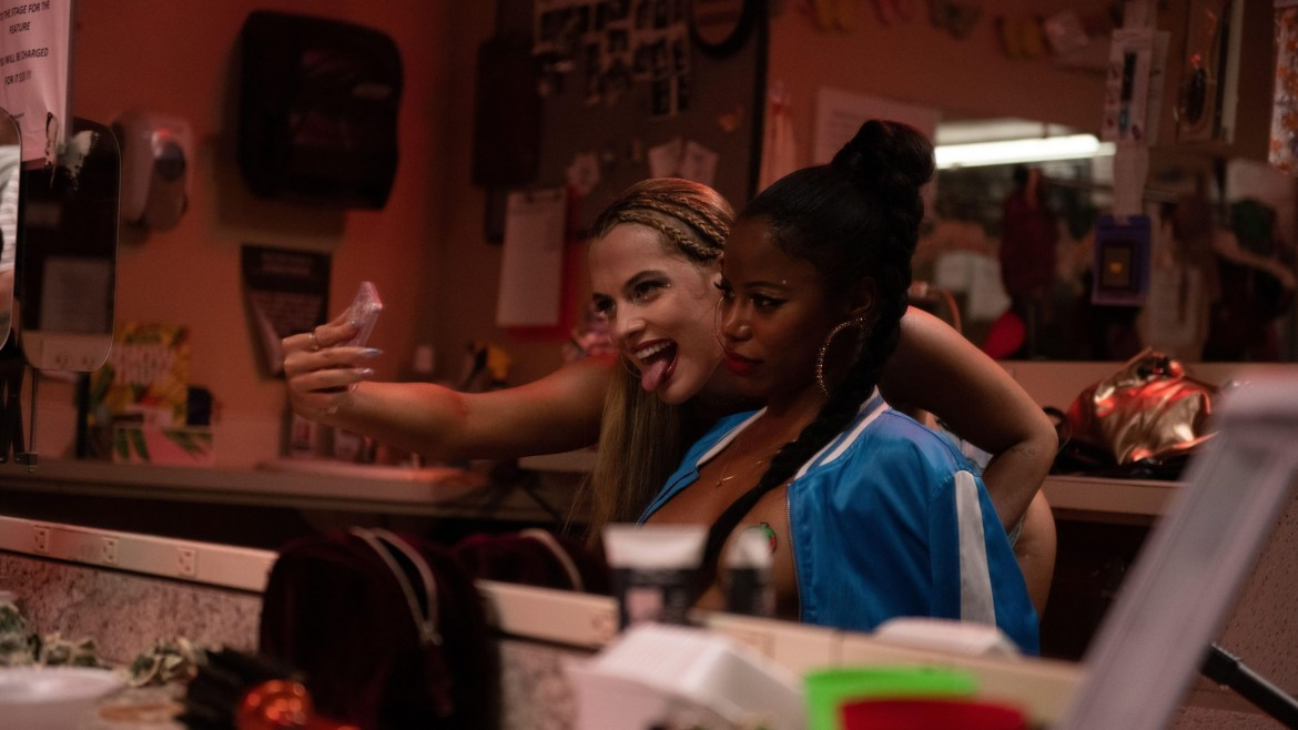 Riley Keough and Taylour Paige doing their makeup together while taking selfies as seen in the new A24 film ZOLA.