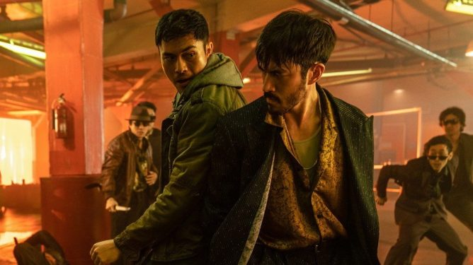 Henry Golding and Andrew Koji fighting a Yakuza clan side by side as seen in the new action movie SNAKE EYES: G.I. JOE ORIGINS.