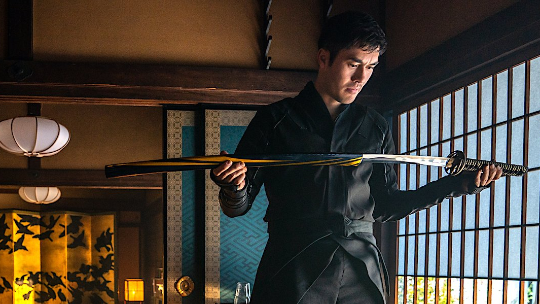 Henry Golding opening his new ninja blade for the first time as seen in SNAKE EYES: G.I. JOE ORIGINS.