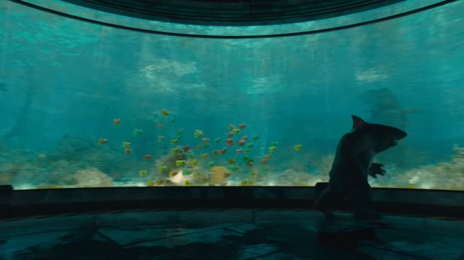 King Shark running with mutant fish in a huge aquarium as seen in the latest DC film THE SUICIDE SQUAD directed by James Gunn.