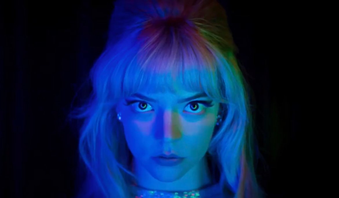 Anya Taylor-Joy in neon blue and green lighting as seen in LAST NIGHT IN SOHO directed by Edgar Wright.
