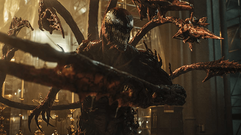 Carnage, ready for battle, sticks out all of his tentacles and claws as seen in VENOM: LET THERE BE CARNAGE starring Tom Hardy and Woody Harrelson