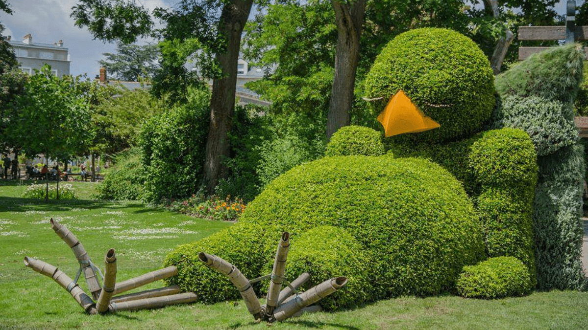 topiary sculpture of a sleeping baby bird