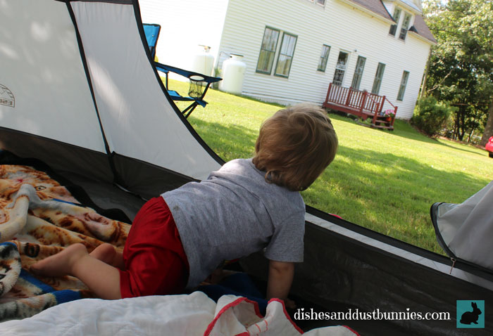 Donnie having fun in the tent in the front yard