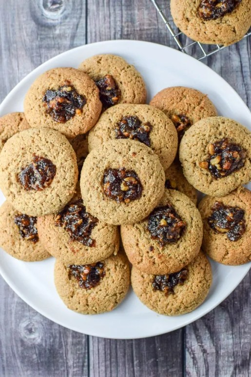 Overhead shot of the delicious thumbprint date nut cookies on a plate