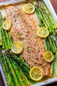 One-Pan Salmon Asparagus Dinner on pan with lemon