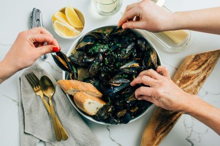 mussels - People sharing mussels and white wine sauce