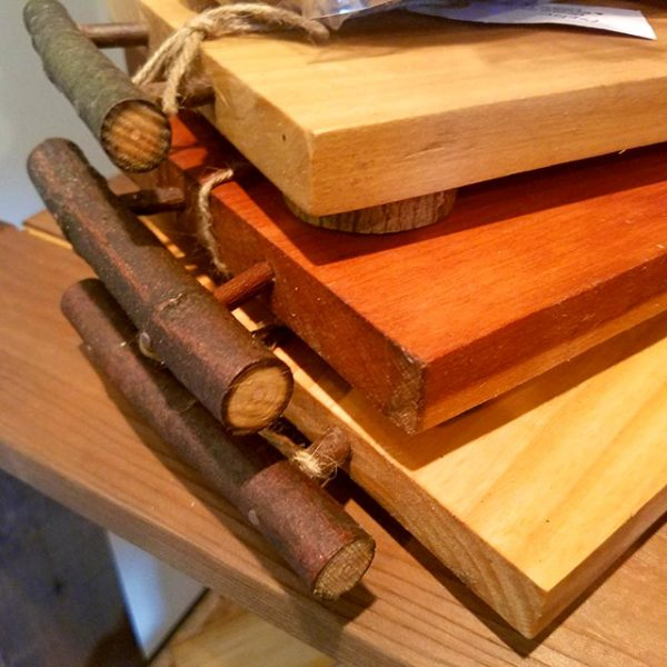 Assorted rustic wooden cheese boards.