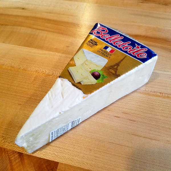 A wedge of Belletoile Triple Cream cheese.
