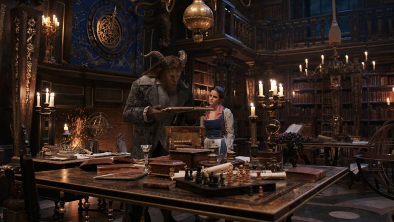 Beauty and the Beast look at a magic book together