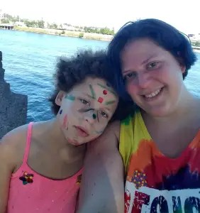The author and her child exhausted and happy after celebrating Pride