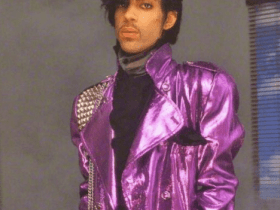 Prince in shiny purple trench coat