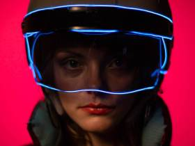 close up of woman's face wearing a helmet with visor