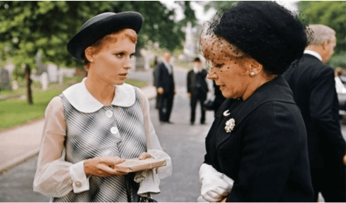 Mia Farrow as Rosemary wearing a dress with a large Peter Pan collar