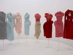 """A display of Comme des Garcons gingham """"bump dresses"""" from 1996"""