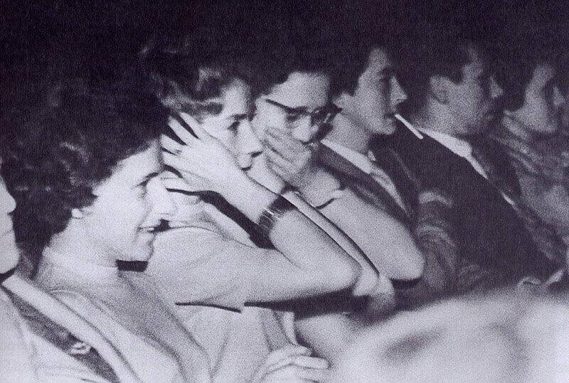 Black and white movie audience. Different reactions tactical consumption.