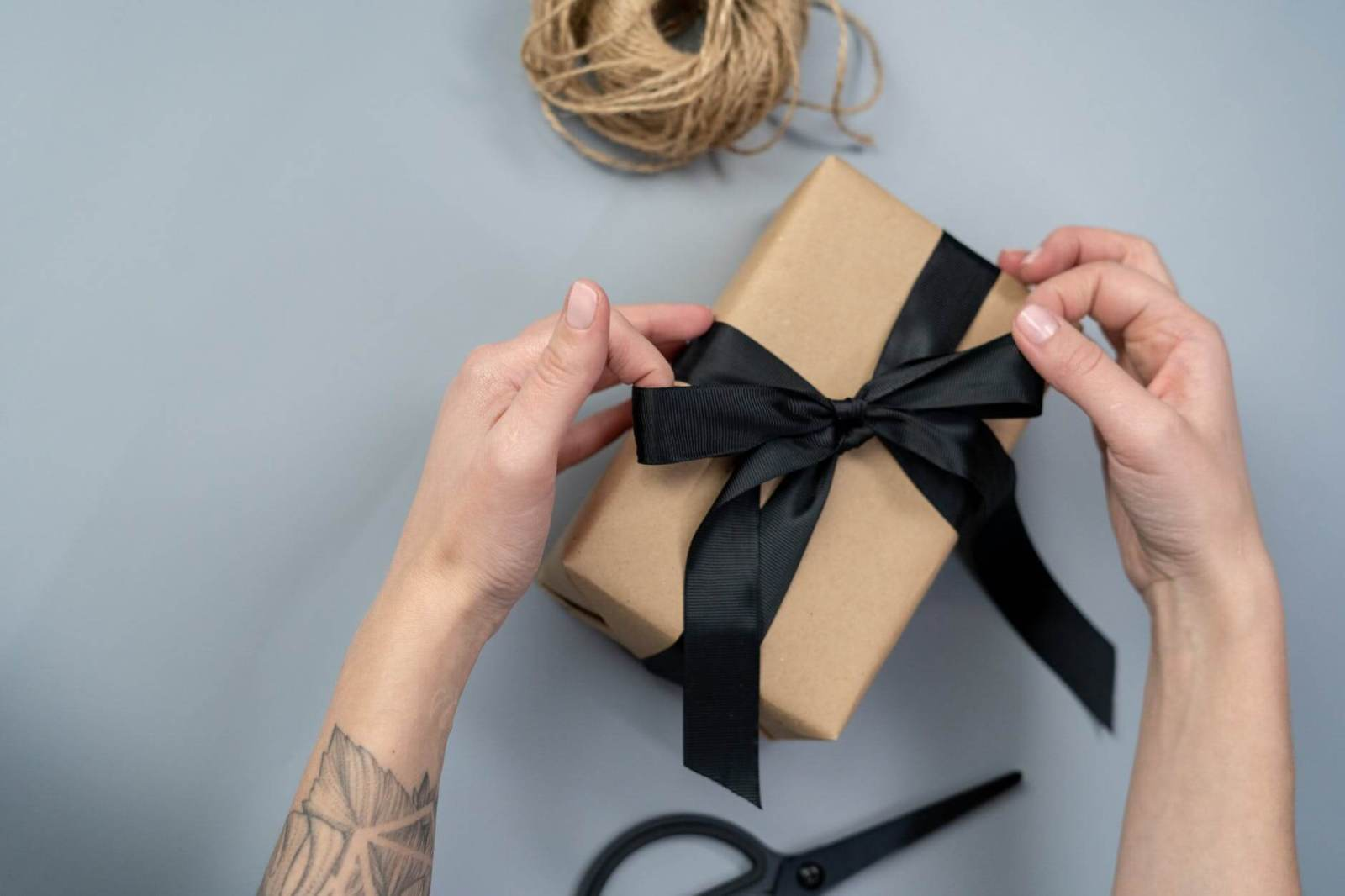 ethical shopping brown gift box with black ribbon