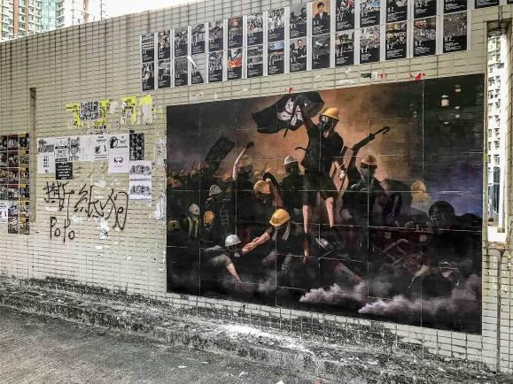 mural depicting black bloc protesters in Hong Kong.