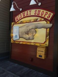 Outlet under Midway Shops sign