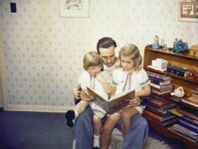 Walt reading to his daughters. via Yahoo! movies