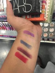 Swatches of UD's Alice Through the Looking Glass lipsticks.