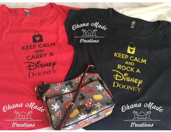 "3866dd1ab Customize this ""Keep Calm and Carry a Disney Dooney"" Shirt to Match Your  Favorite Bag"