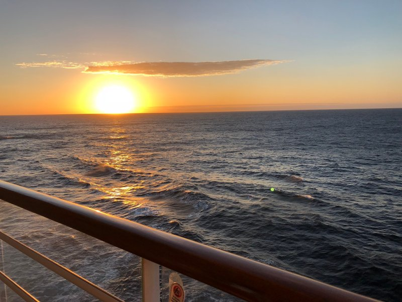 A sunset seen from the verandah of a stateroom on a Disney Cruise ship