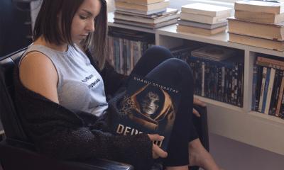 Beautiful Girl reading Deified by Bhanu Srivastav