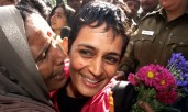 Roy is kissed by supporters in 2002 after being released from Tihar Jail in New Delhi. She had been jailed during a campaign against a new dam