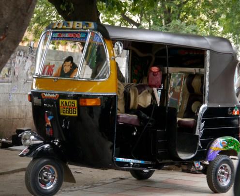 Auto rickshaw on pavement