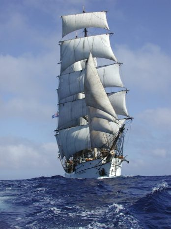 Tall ship with sails raised