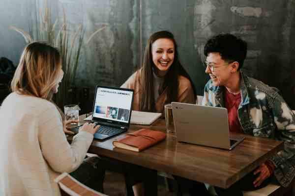 remote employees sharing a coworking space