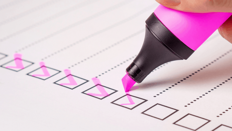 Checklist with pink highlighter.