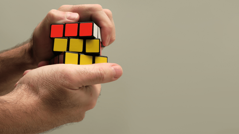 Person solving a rubik's cube